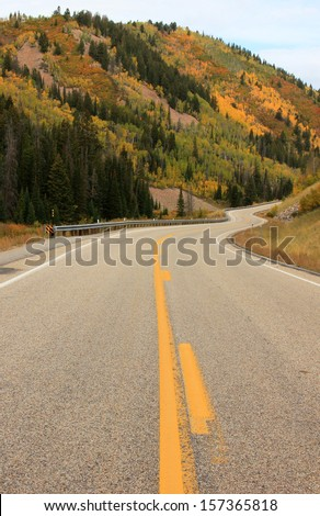 Winding mountain road with autumn color, Utah, USA. - stock photo