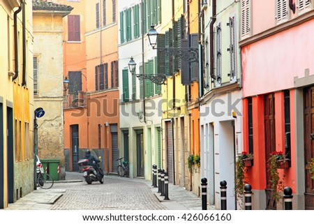 Winding old street with colorful architecture in Parma, Emilia-Romagna province, Italy. - stock photo
