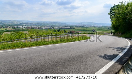 Winding Paved Road in Piedmont, Italy, Vintage Style Toned Picture - stock photo