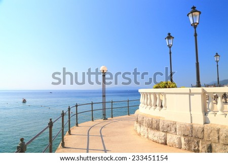 Winding promenade under the sun near Adriatic sea, Opatija, Croatia - stock photo
