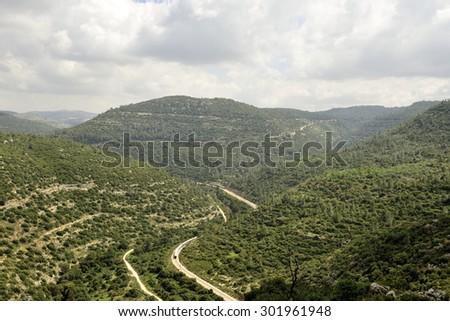 Winding railroad in wadi Sorek in Jerusalem mountains. - stock photo