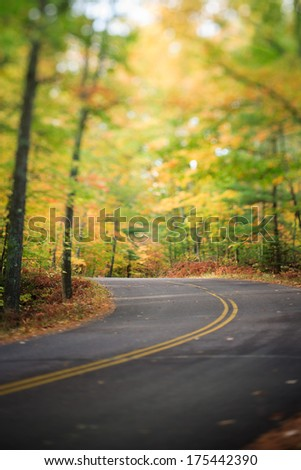 Winding Road Highway Through the North Woods Forest, Wisconsin in the Fall - stock photo