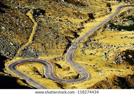 Winding road in Fagaras Mountains, Romania - stock photo