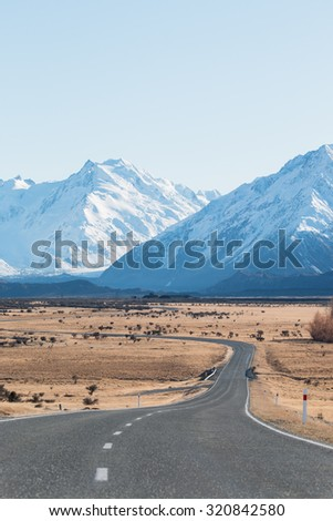 Winding road in high country,  New Zealand - stock photo
