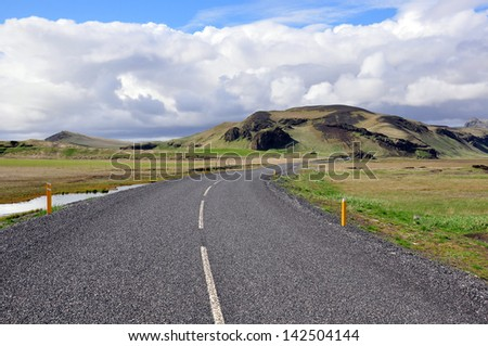 Winding road in Iceland - stock photo