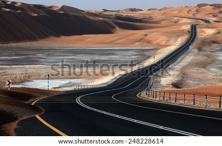 Winding road in Liwa, UAE - stock photo