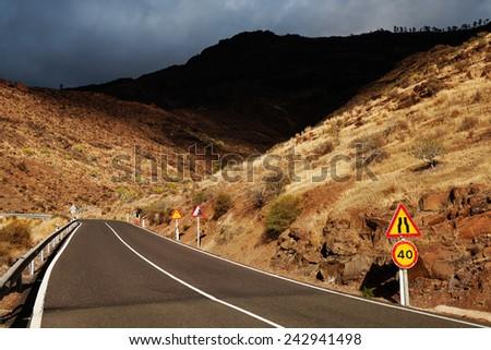 Winding road in Parque Natural de Pilancones, Gran Canaria, Spain  - stock photo