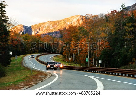 winding road in the autumn mountain forest in white mountain