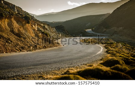 winding road in the mountain - stock photo