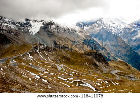 Winding road in the mountains - stock photo