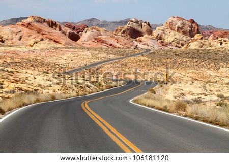 Winding road through desert - stock photo