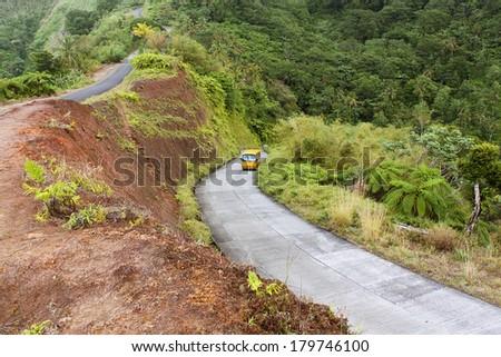 Winding road through Dominica, Caribbean islands - stock photo
