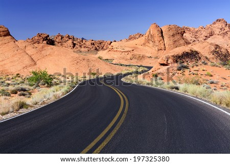 Winding road through red rocks, Valley of Fire State Park, Nevada. - stock photo