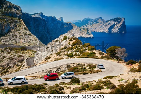 winding road with parked cars on the Cap de Formentor in Mallorca, Spain - stock photo