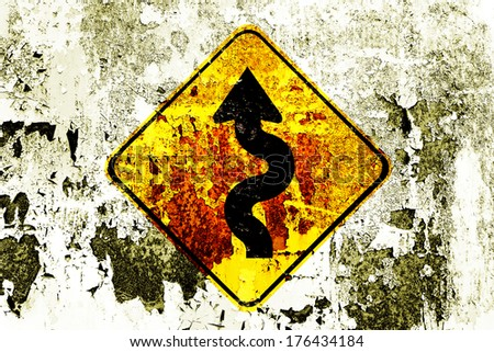 Winding roadsign on a grunge background - stock photo