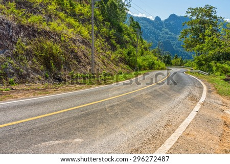 Winding roadway in countryside of Thailand