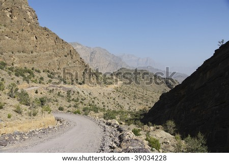 winding rough road - stock photo