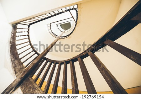 winding staircase in an old house - stock photo