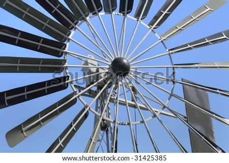 windmill against blue sky - stock photo