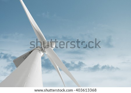Windmill against cloudy sky with copyspace