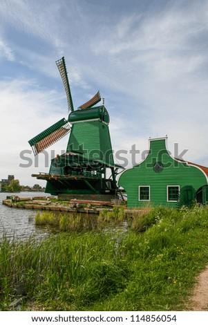 Windmill along river, Zaanse Schans, Netherlands - stock photo