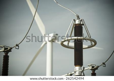 Windmill and electrical substation, Zaragoza province, Aragon, Spain. - stock photo