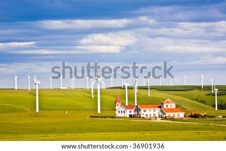 windmill and house in the grassland - stock photo