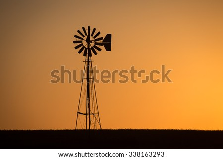 Windmill at Dusk/An old windmill stands on the prairie as another day ends.