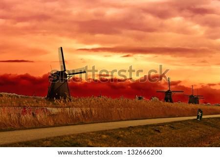 Windmill at sunset. Dutch landscape - stock photo