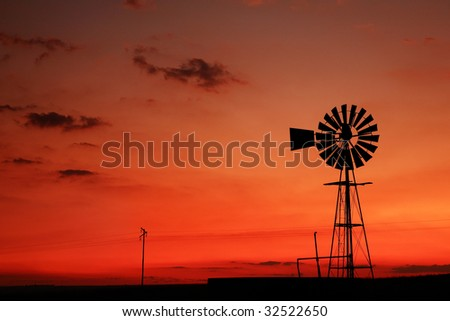 Windmill at sunset in South Africa - stock photo