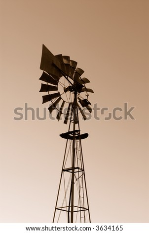 Windmill at sunset in the desert