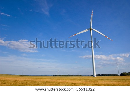 Windmill conceptual image. Windmill on the field. - stock photo