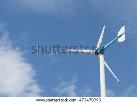 windmill for electric generator with cloud and blur sky