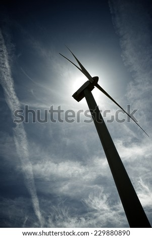 Windmill for electric power production at sunset, Zaragoza Province, Aragon, Spain - stock photo