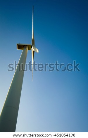Windmill for electric power production. Producing alternative energy. - stock photo