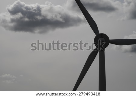 Windmill for electric power production with clouds - stock photo