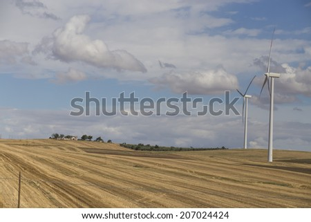 Windmill for eolic energy in Italy - stock photo