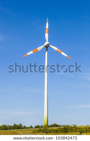 Windmill gathers energy from the summer breeze.