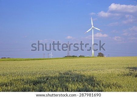 Windmill generator in a field of wheat