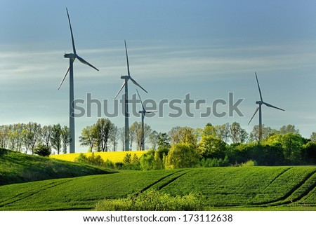 windmill, group of aligned windmills for electric power generation alternative - stock photo