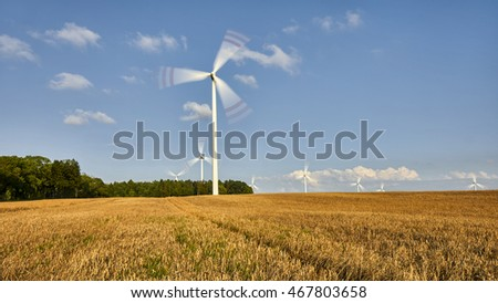 windmill, group of aligned windmills for electric power generation alternative - panorama
