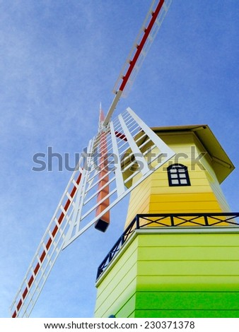 Windmill house on blue sky background  - stock photo