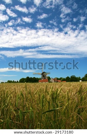 Windmill in field with blue sky