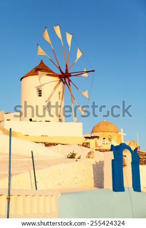 Windmill in Oia, Santorini during a sunny summer day - stock photo