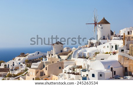 Windmill in Oia, Santorini. Oia is a village in the north west edge of the Santorini island with white houses. - stock photo