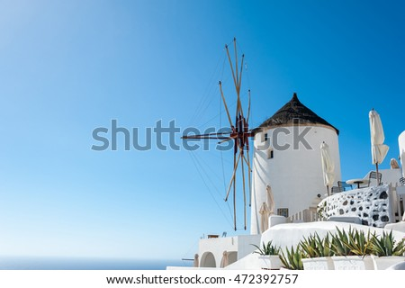 Windmill in the beautiful Oia - Santorini - Greece