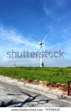 Windmill in the distance - stock photo