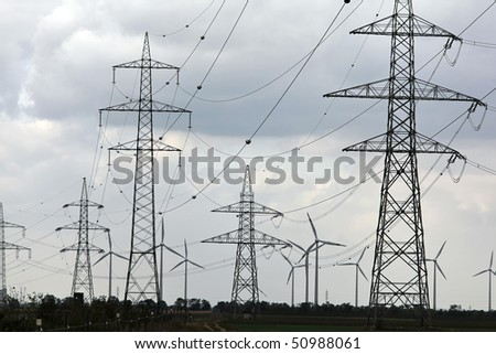 Windmill in the wind power for alternative energy - stock photo
