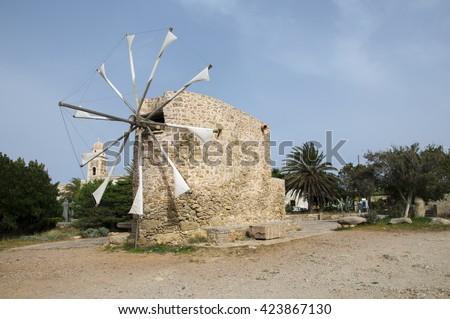 Windmill on Crete Toplou - stock photo