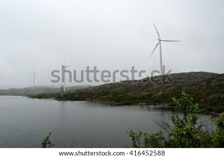 windmill on mountain in thick summer fog